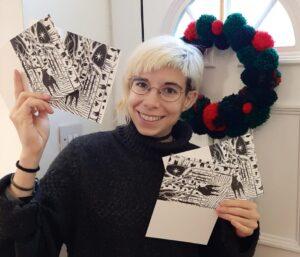 Marina holding her homemade Christmas cards