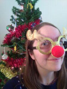 Nikki by Christmas tree