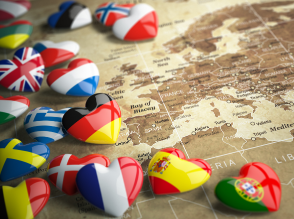 Heart-shaped counters with flags of European countries, placed on a map of Europe