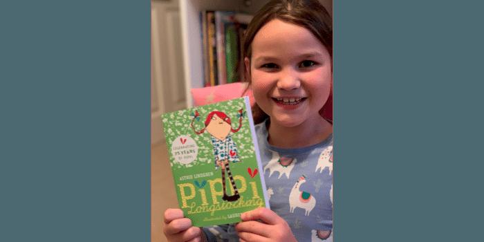 #WorldKidLitMonth | Child holding Pippi Longstocking book