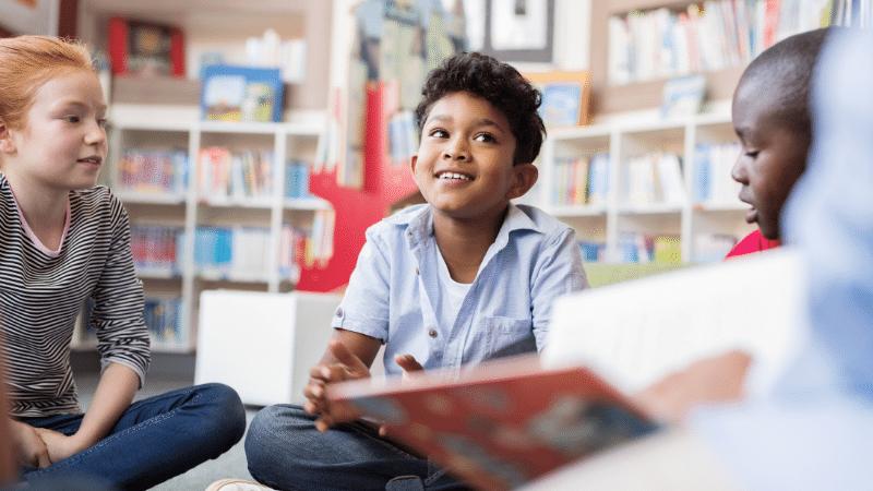 #WorldKidLitMonth | Children sat listening to stories